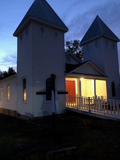 Church and Cross at Sunrise