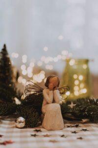 photo of angel figurine near christmas ball